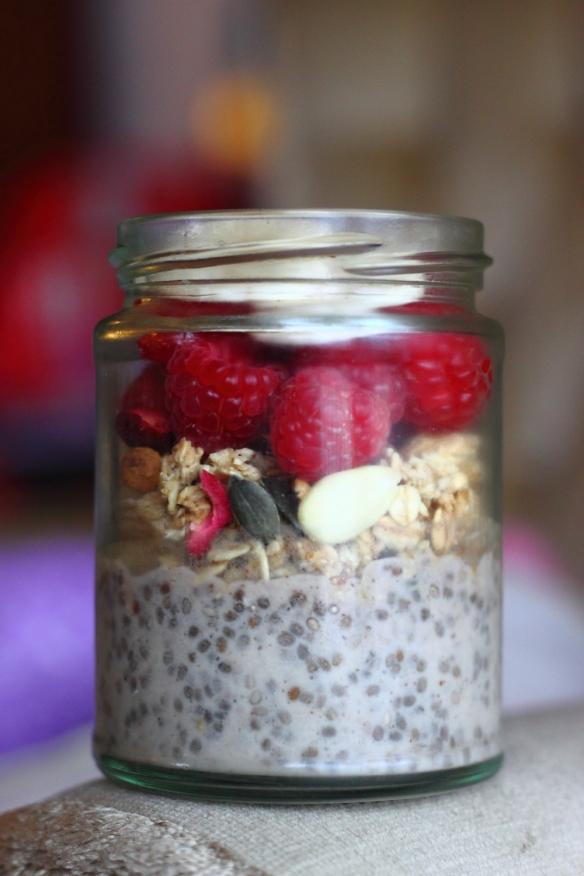 Chia Pudding Layered with Raspberries and Granola